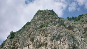 Looking Up a High Mountain Cliff stock footage