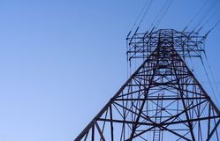 Looking up at an electric transmission tower royalty free stock photo