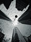 Looking up in Hong Kong. Clouds, dramatic sky above buildings in Hong Kong Stock Image