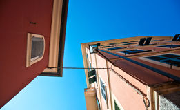 Looking up between the houses Royalty Free Stock Image