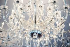 Looking up at a illuminated crystal chandelier royalty free stock photography