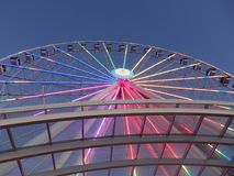 Looking up at large Ferris Wheel with LED lights stock images