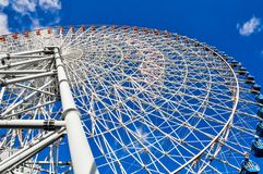 Looking up a large Ferris wheel stock images