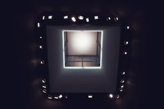 Looking up at lights in modern art museum ceiling royalty free stock photography