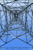 Looking up metal electricity pylon Stock Photo