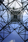 Looking up metal electricity pylon Stock Image