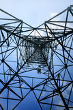 Looking up metal electricity pylon Royalty Free Stock Photo