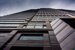 Looking up at a modern building under a cloudy sky in Philadelph Stock Photos