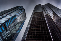 Looking up at modern buildings under a cloudy sky in Philadelphi Stock Images
