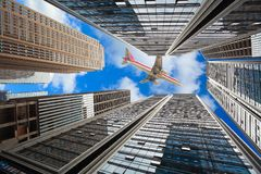 Looking up at modern city buildings backgrounds stock image