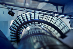 Looking up at modern glass stairway Royalty Free Stock Images
