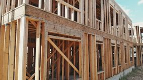 Looking up new construction beams under a clear blue sky with sunlight. Looking up at new construction beams under a clear blue sky with sunlight stock footage