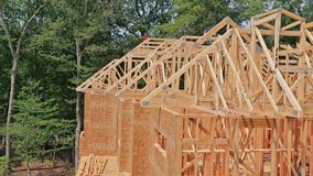 Looking up new construction beams under a clear blue sky with sunlight. Looking up at new construction beams under a clear blue sky with sunlight stock video footage