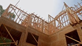 Looking up new construction beams under a clear blue sky with sunlight. Looking up at new construction beams under a clear blue sky with sunlight stock video