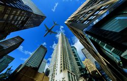 Looking up at New York city skyscrapers in financial district, NYC USA plane flying. Looking up at New York city skyscrapers in financial district, NYC USA royalty free stock photography