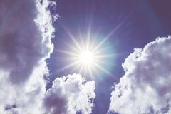 Looking up at Nice blue sky with sun beam and halo with cloudy,V Royalty Free Stock Image