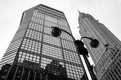 Looking Up NYC. Classic New York City skyscrapers in black and white as seen from Lexington Ave in Manhattan Stock Photo