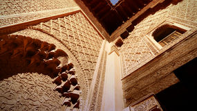 Looking up at the old Koranic School decorations in Marrakech in the late afternoon Royalty Free Stock Images