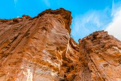 Eroding orange sandstone cliffs. stock photography