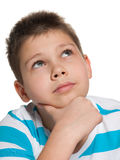 Looking up pensive boy Stock Photography