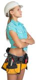 Looking up pretty girl in helmet, shorts, shirt Stock Image