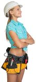 Looking up pretty girl in helmet, shorts, shirt Stock Photo