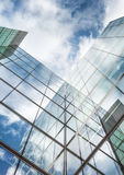 Looking up at reflections on glass covered corporate buildings Royalty Free Stock Photos