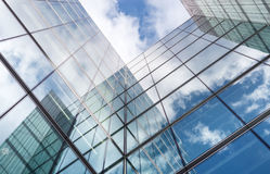 Looking up at reflections on glass covered corporate buildings Royalty Free Stock Photography