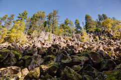 Looking up at rocky cliffs and rock slide, Brandywine Falls Stock Photos