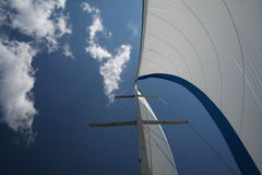 Looking up at sail with clouds. A Sail on the mast of a sail boat, sailing out of Gothenburg harbour. Swedem during summer 2006 with fine weather Stock Photography