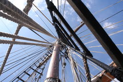 Looking up sailing ship mast into the rigging - strong perspective. Looking directly up mast on a tall ship. Strong sense of depth and perspective Royalty Free Stock Photography