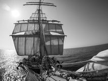 Looking up at sailors working, on traditional sailing vessel Stock Photo