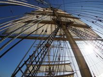 Looking up at the sails of a traditional tallship Royalty Free Stock Photo