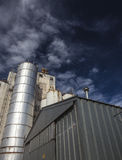 Looking Up the Silo. Looking up an old abandoned grain elevator and shack in Colorado farmland. Dramatic Sky Royalty Free Stock Photo