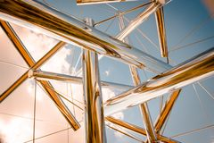 Looking up at the sky through an abstract chrome statue at the Frederik Meijer Gardens royalty free stock photo