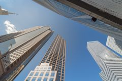Looking up of skyline buildings in downtown Dallas, Texas, USA c. Wide angle upward view of skyscrapers against cloud blue sky in the business district area of royalty free stock photography