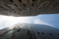 Looking up between skyscrapers Stock Photos