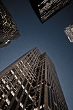 Looking up at skyscrapers Stock Photography