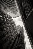 Looking up at skyscrapers in New York. Looking at the sky between skyscrapers in New York City Stock Image