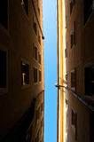 Looking up in a small alley way. Looking up on a sunny day in a small alley way Stock Photos
