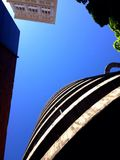 Looking Up at Spiral Parking Garage Ramp and Building and Tree. On a bright sunny day Stock Images