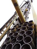 Looking up at stacked drill pipe on a drill rig. Stock Photo