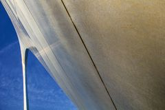 St. Louis, Missouri, United States-circa 2014-Looking up at the Gateway Arch close up exaggerated curving leg and blue sky Stock Images