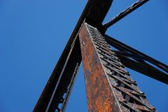 Looking up at a steel train bridge structure royalty free stock photography