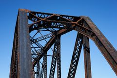 Looking up at a steel train bridge structure stock photo
