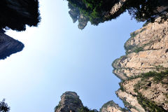 Looking up of steep stone mountain at zhangjiajie Royalty Free Stock Photo