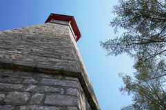 Looking Up at a Stone Lighthouse. Viewing a stone lighthouse from ground level, looking up on the Toronto Islands royalty free stock photo