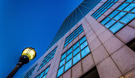 Looking up at a streetlight and the PNC Bank Center building in stock photo