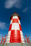 Looking up at Tall Red and White Lighthouse Royalty Free Stock Images