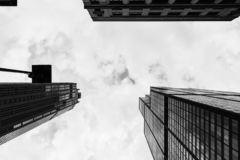 Looking up tall skyscrapers in an urban city stock photography